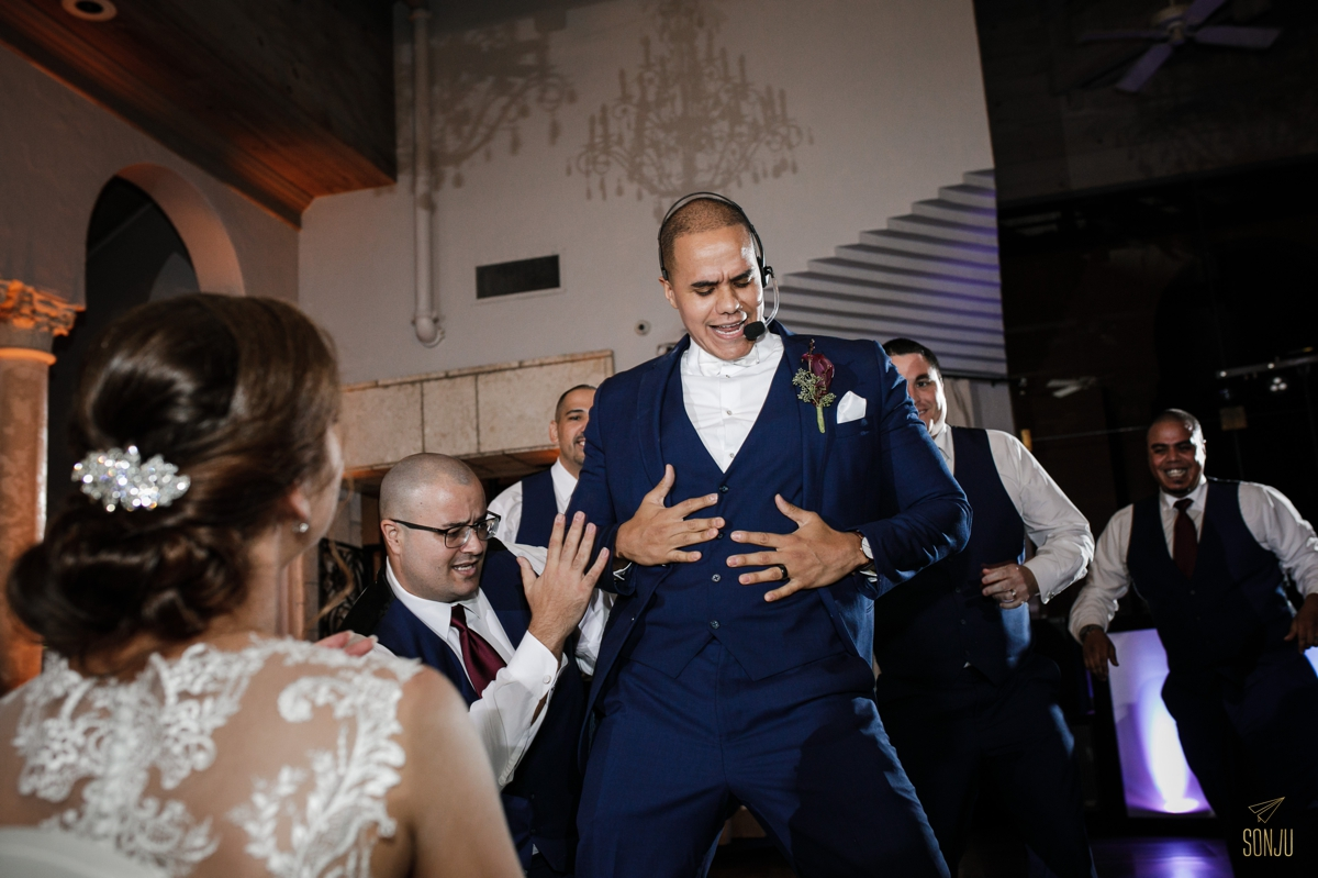 choreographed-groomsmen-dance-surprises-bride-at-coral-gables-country-club-miami-wedding-photographer