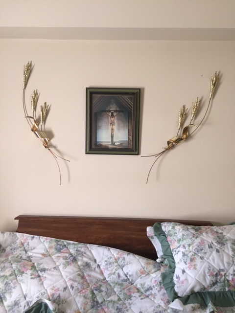 Making sure these special pieces were hanging in this arrangement above Mrs. A's bed in her new residence was an important factor in our resettling process.