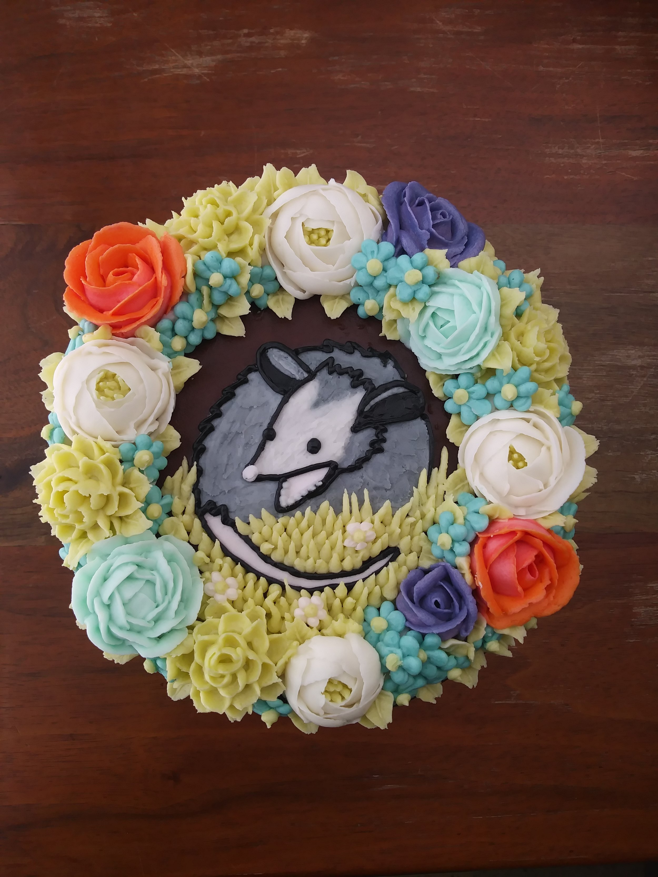 A38. Possum and Flowers cake in Buttercream ($30 Deco).JPG