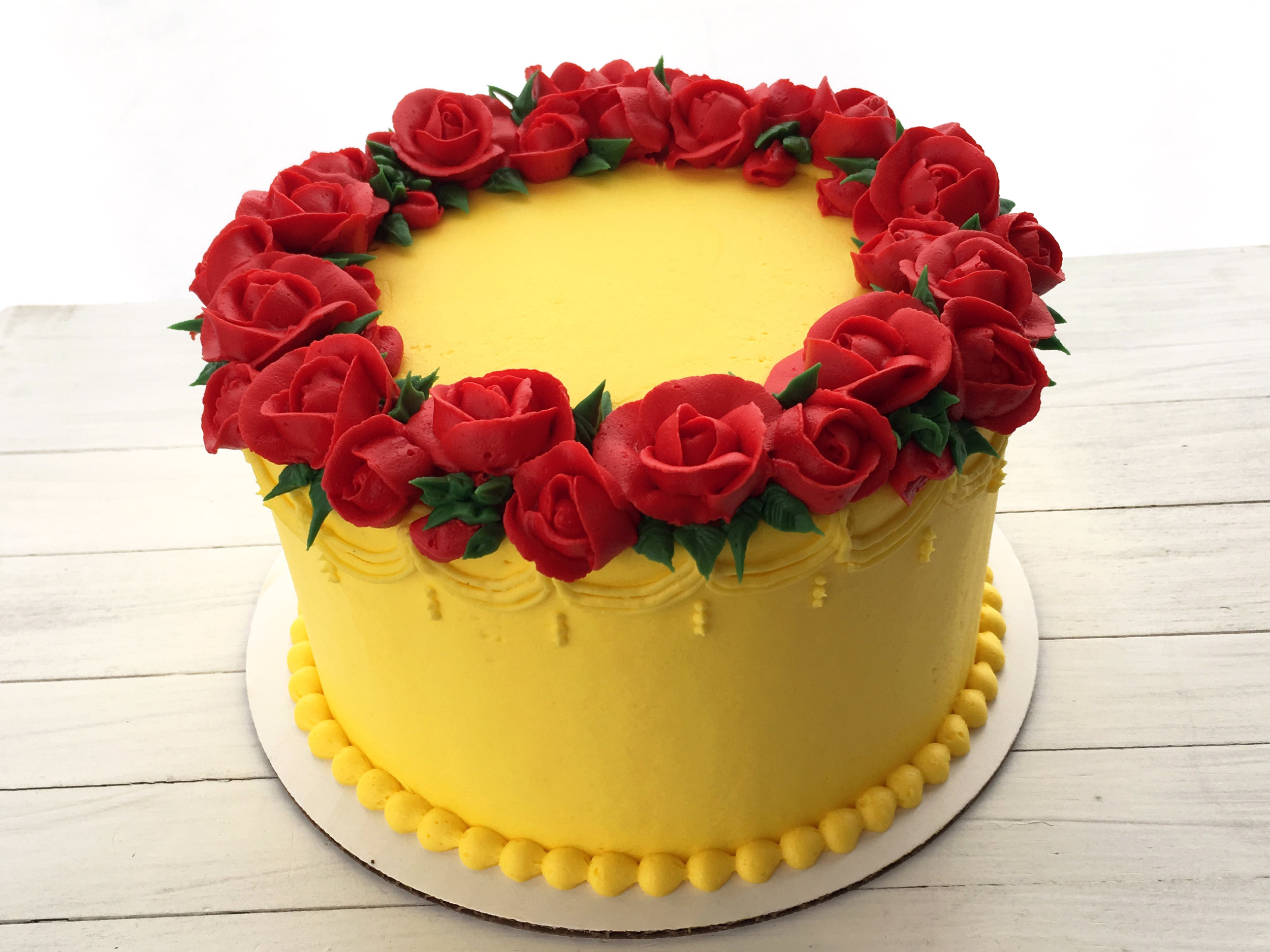 A4. Beauty & The Beast Yellow Cake ($15 Deco).jpg