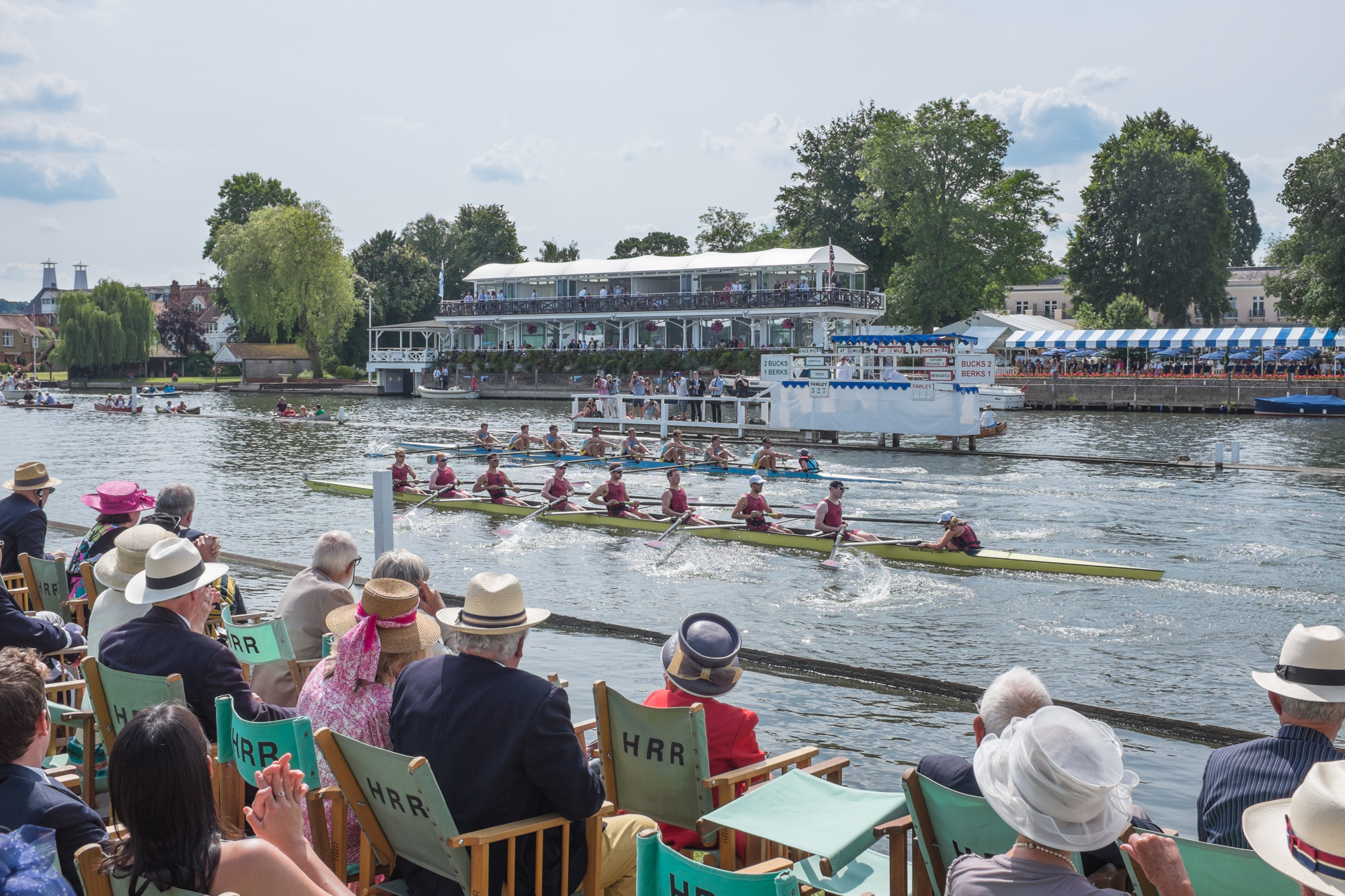Crews from the Cambridge 99 Rowing Club and Vesta Rowing Club battle it out for a place in the next round of the Thames Challenge Cup at Henley Royal Regatta