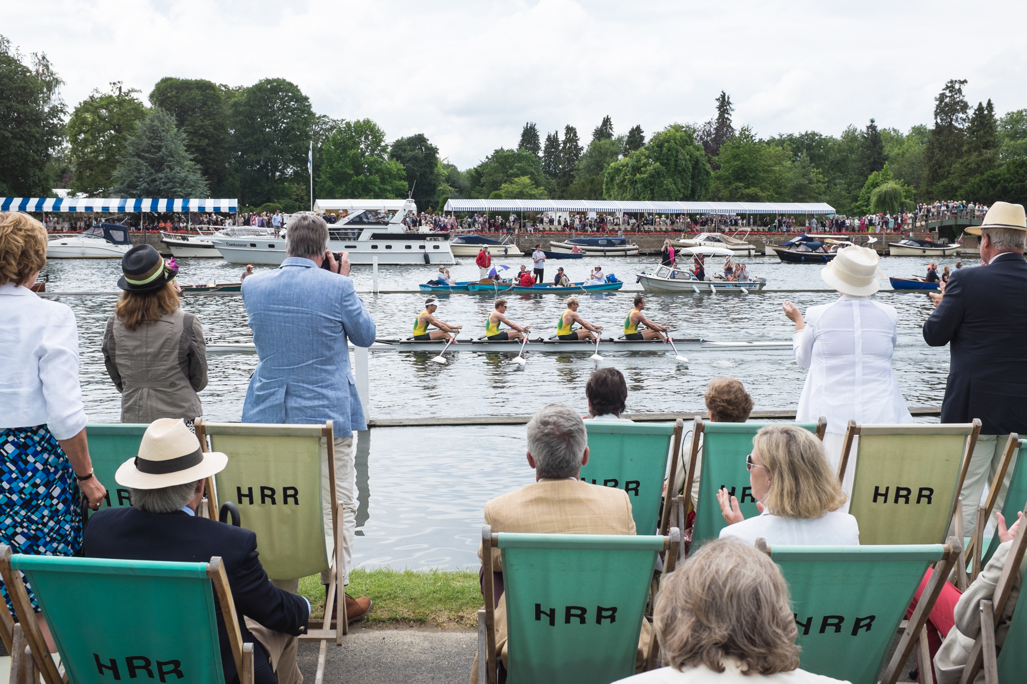 Spectators at Henley Royal Regatta applaud an Australian coxless four as it approachs the finish line.