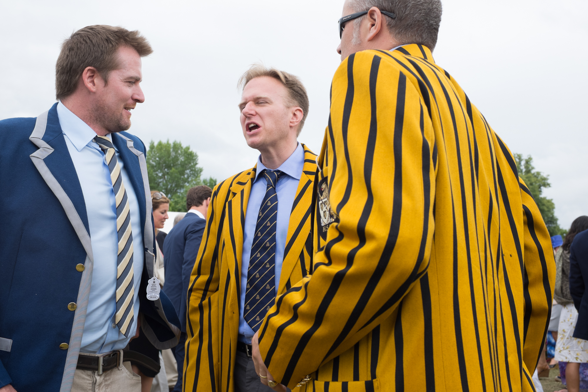 Catching up with friends at Henley Royal Regatta. Lots of spectators have been coming to the regatta for a great many years, and still wear their club colours with pride.