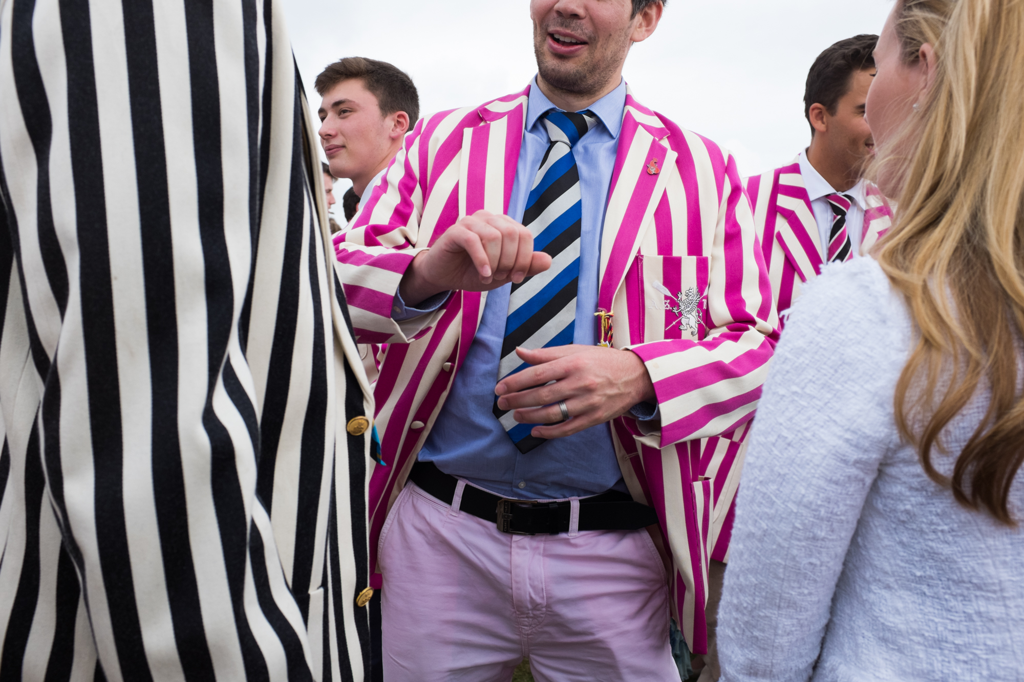 Rowers from Abingdon School, wearing their distinctive blazers, mingle with the crowds  at Henley Royal Regatta.
