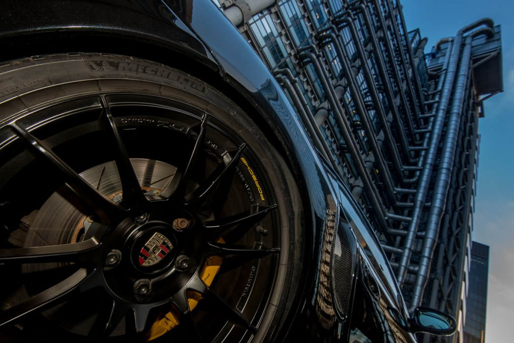 Porsche 996 rear wheel and tyre with London Lloyds building in the background