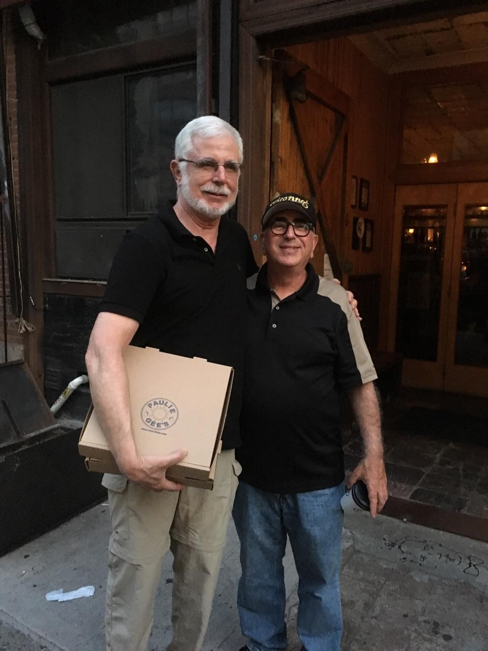 Charlie with Paulie Gee.  Of note: The pizza boxes were for leftovers,  not  take out (this will make sense when you listen to episode #035).