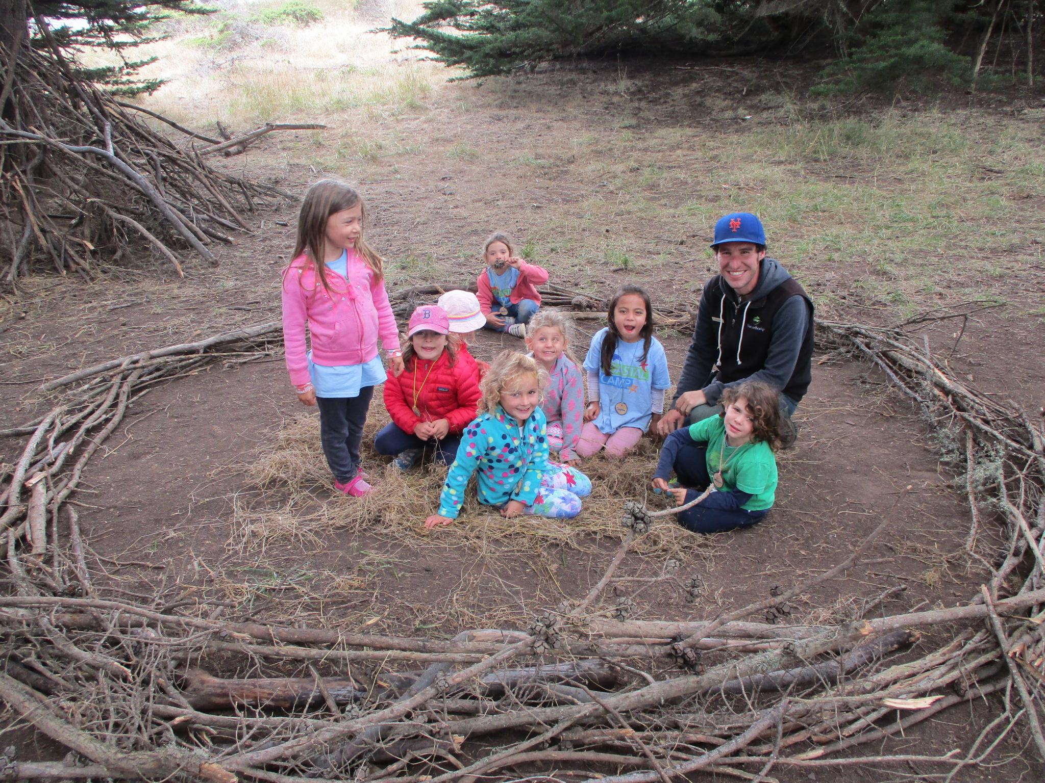 Kinder campers build a nest
