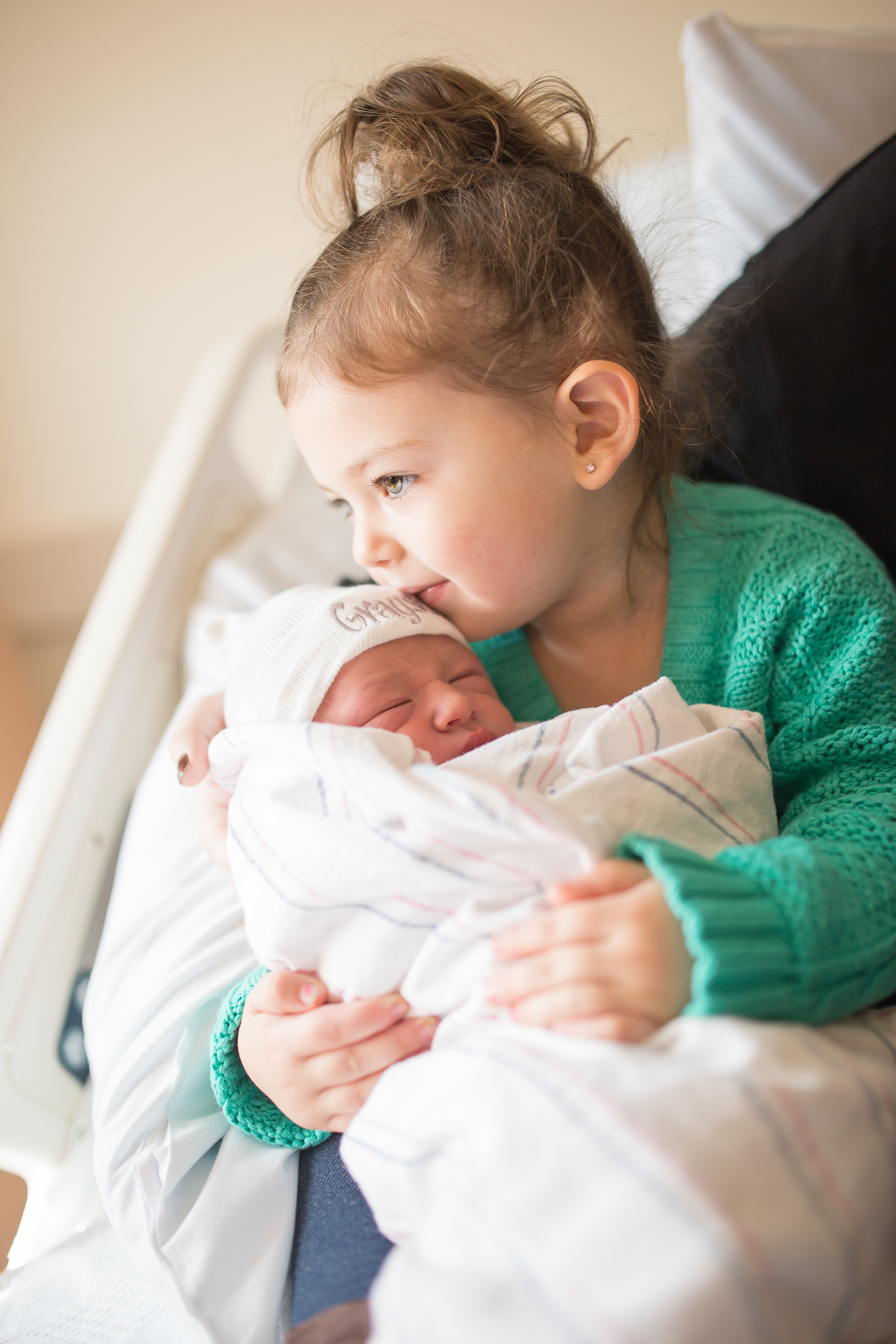 Toddler holds new baby brother - Fresh 48 session in Boston