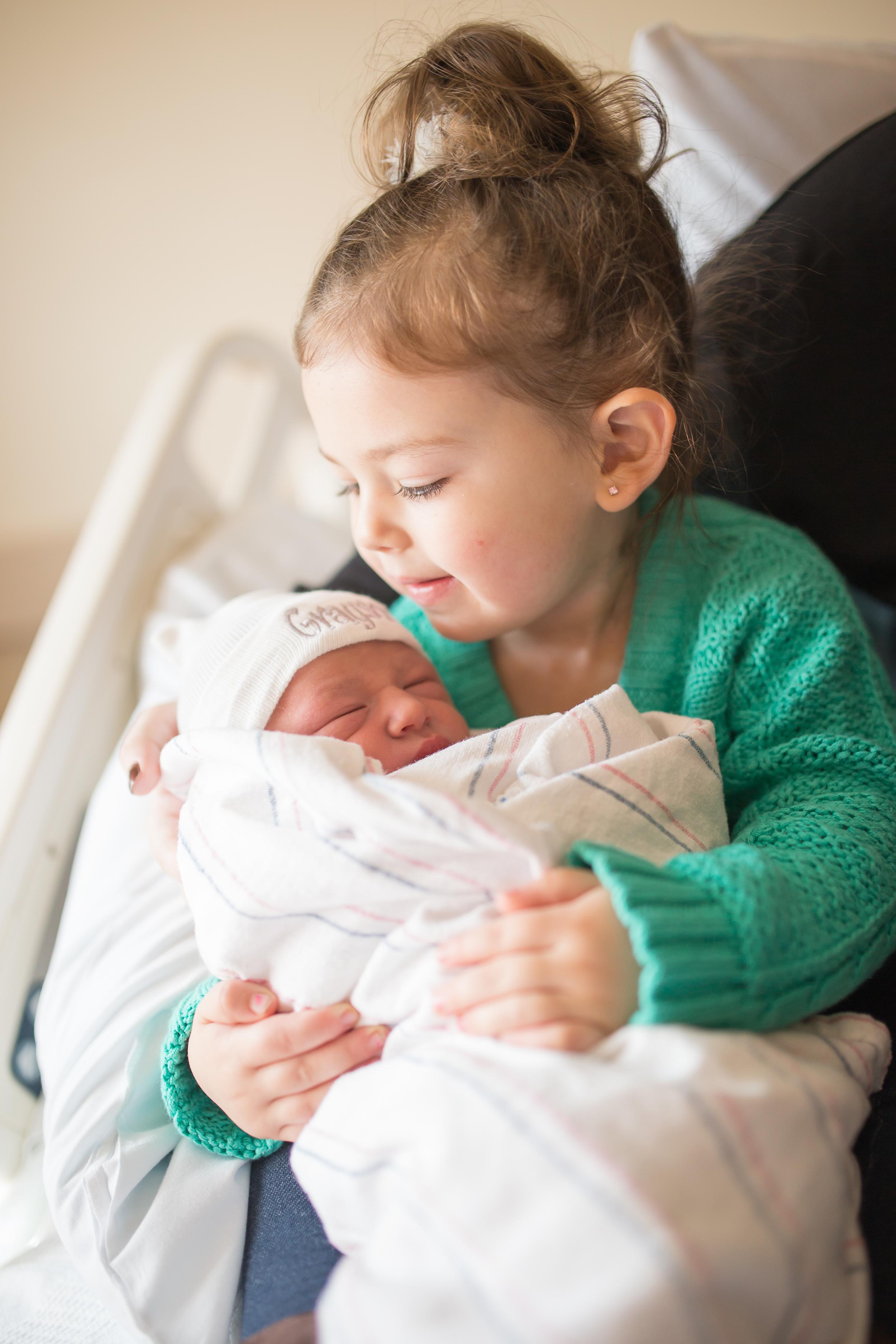 Toddler holds Newborn in-hospital in Boston Massachusetts