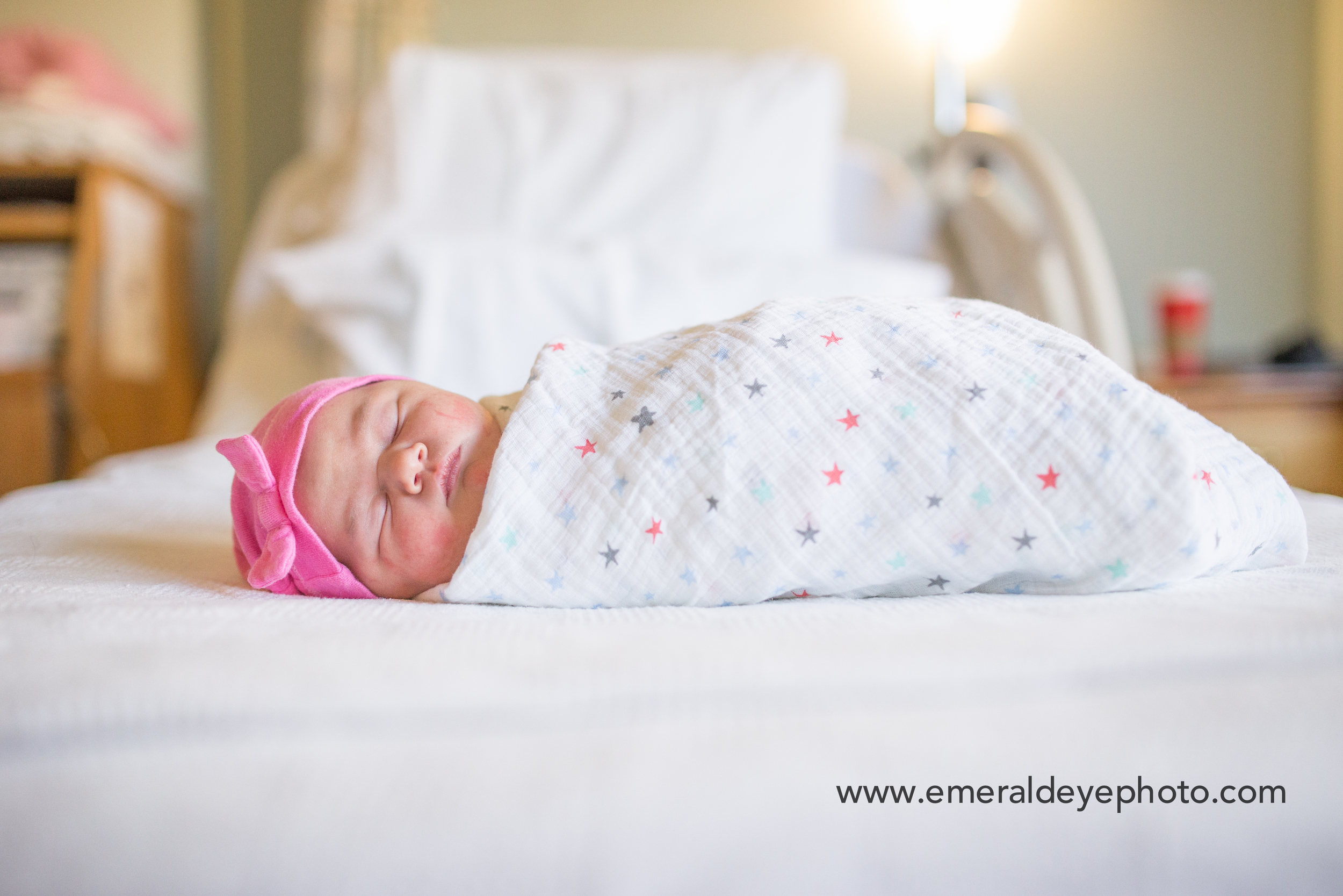 Baby swaddled on hospital bed during Fresh 48 session in Falmouth Massachusetts