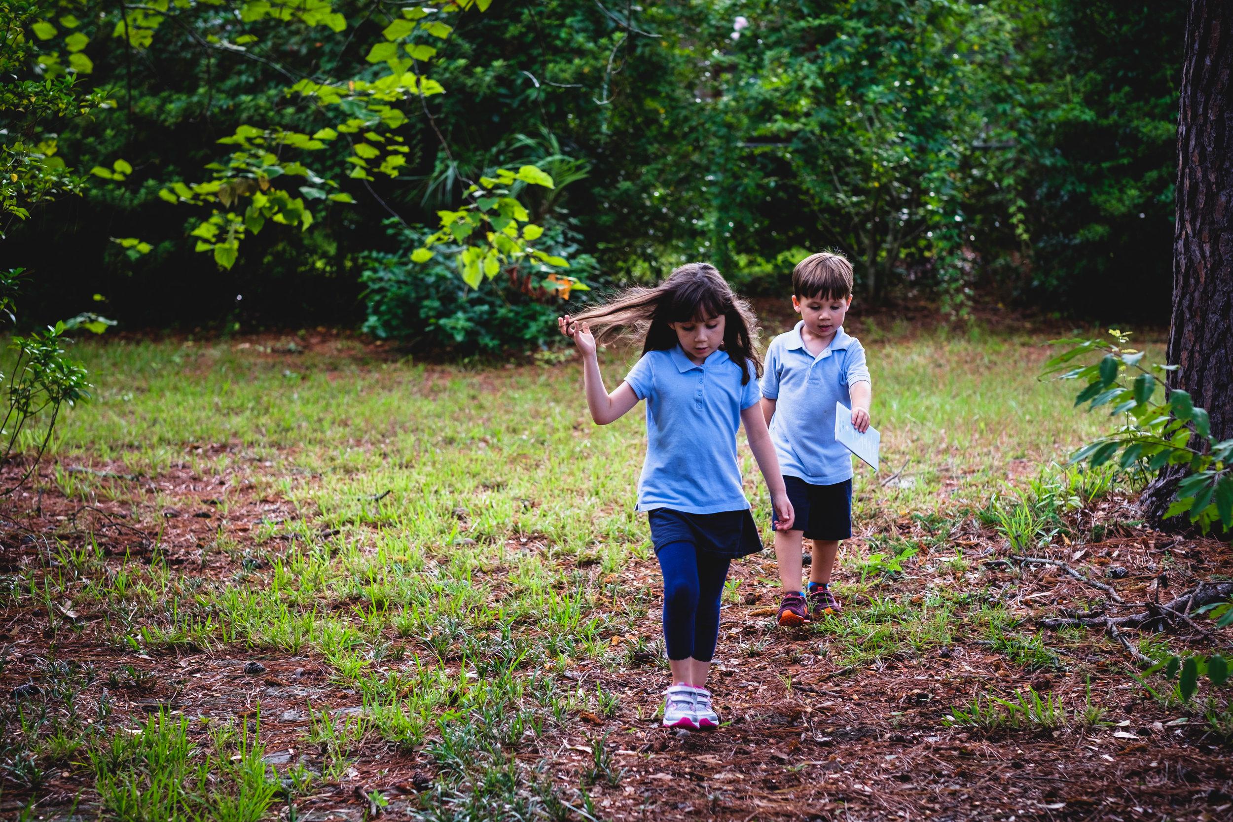 Siblings hard at play.