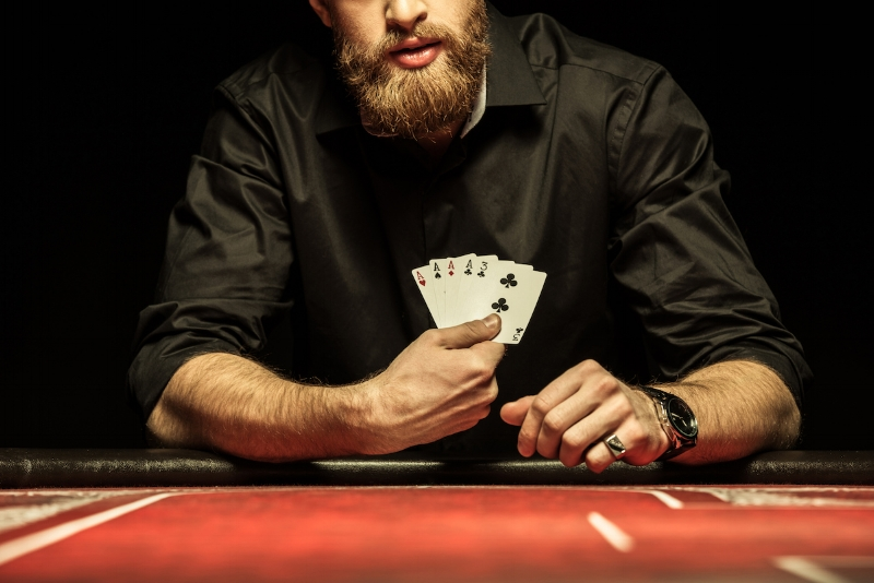 Cropped-shot-of-bearded-man-showing-poker-cards (Sized).jpg