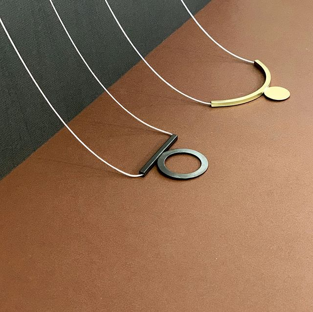 We're known for our earrings, but let's take a moment to admire two of our best selling necklaces. The Black Hole and Floating Circle Necklaces, just begging to be put over a turtleneck.