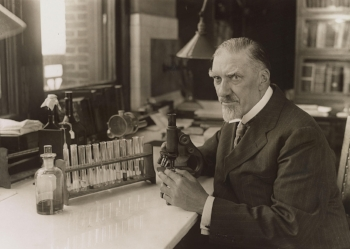 Dr. Charles Norris in his lab in the 1920s.