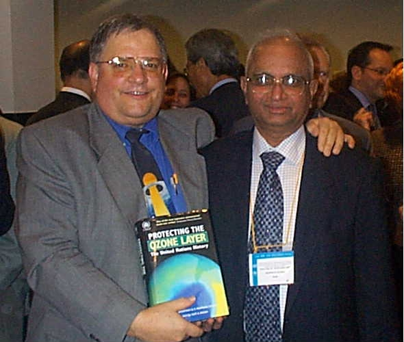 Stephen Andersen (left) and Madhava Sarma at Montreal Protocol meeting 2002 where they launched their book,  Protecting the Ozone Layer .