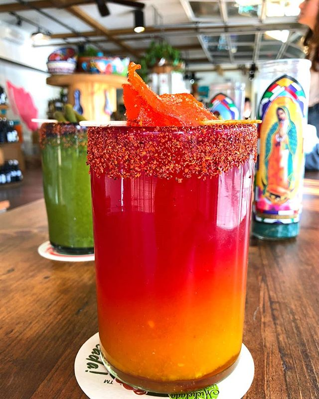 Is this #sunset in a glass getting you excited for Summer? 😎 Good thing these #Micheladas from @altabajamarket are perfect any time of year! 🍹 #4thStreetMarket #DTSA #SantaAna