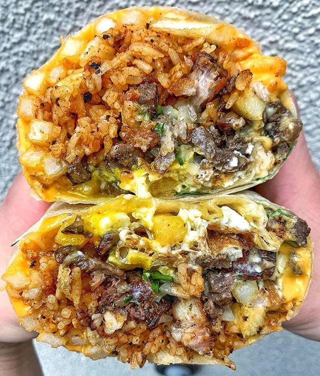 We can already imagine the food babies after devouring this Stoner Burrito from @doschinos 🌯 😂 Packed with rice, roasted #pork, asada, a fried #egg, cheese, onion, cilantro, and Southeast Asian salsa verde 🤤 #4thStreetMarket #DTSA #DosChinos