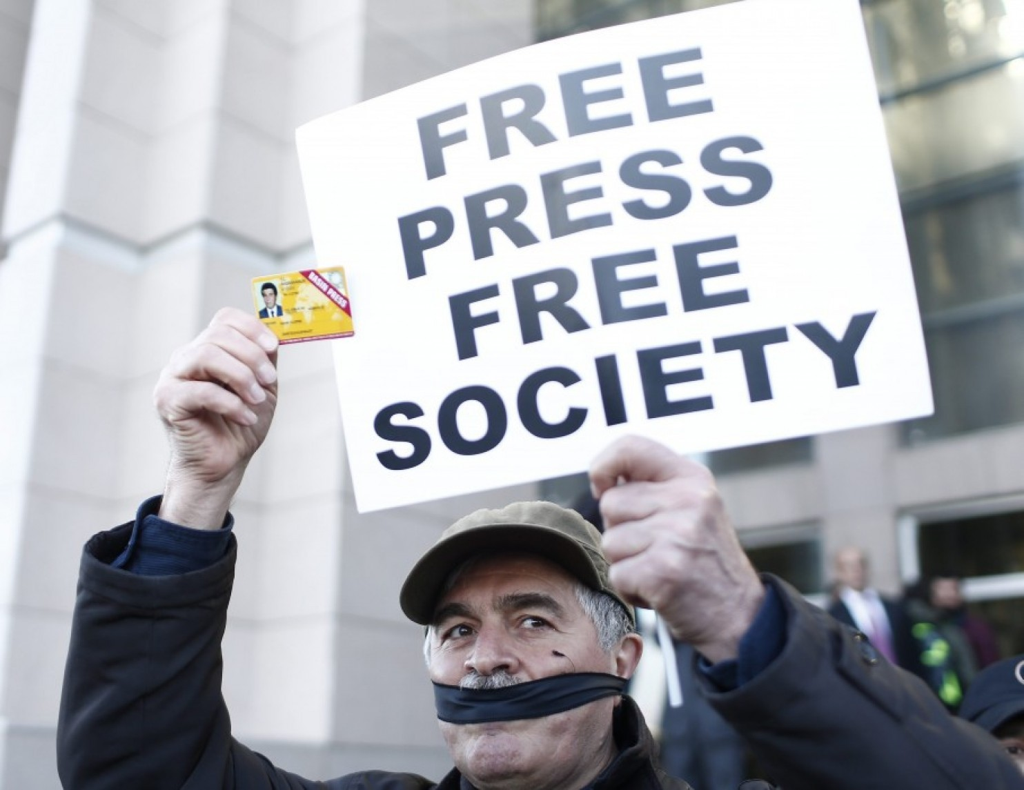 A Turkish protester holds a placard and a press card on April 1 before the trial of two journalists. Turkey ranks 151 out of 180 countries in terms of press freedom. (Sedat Suna/European Pressphoto Agency)