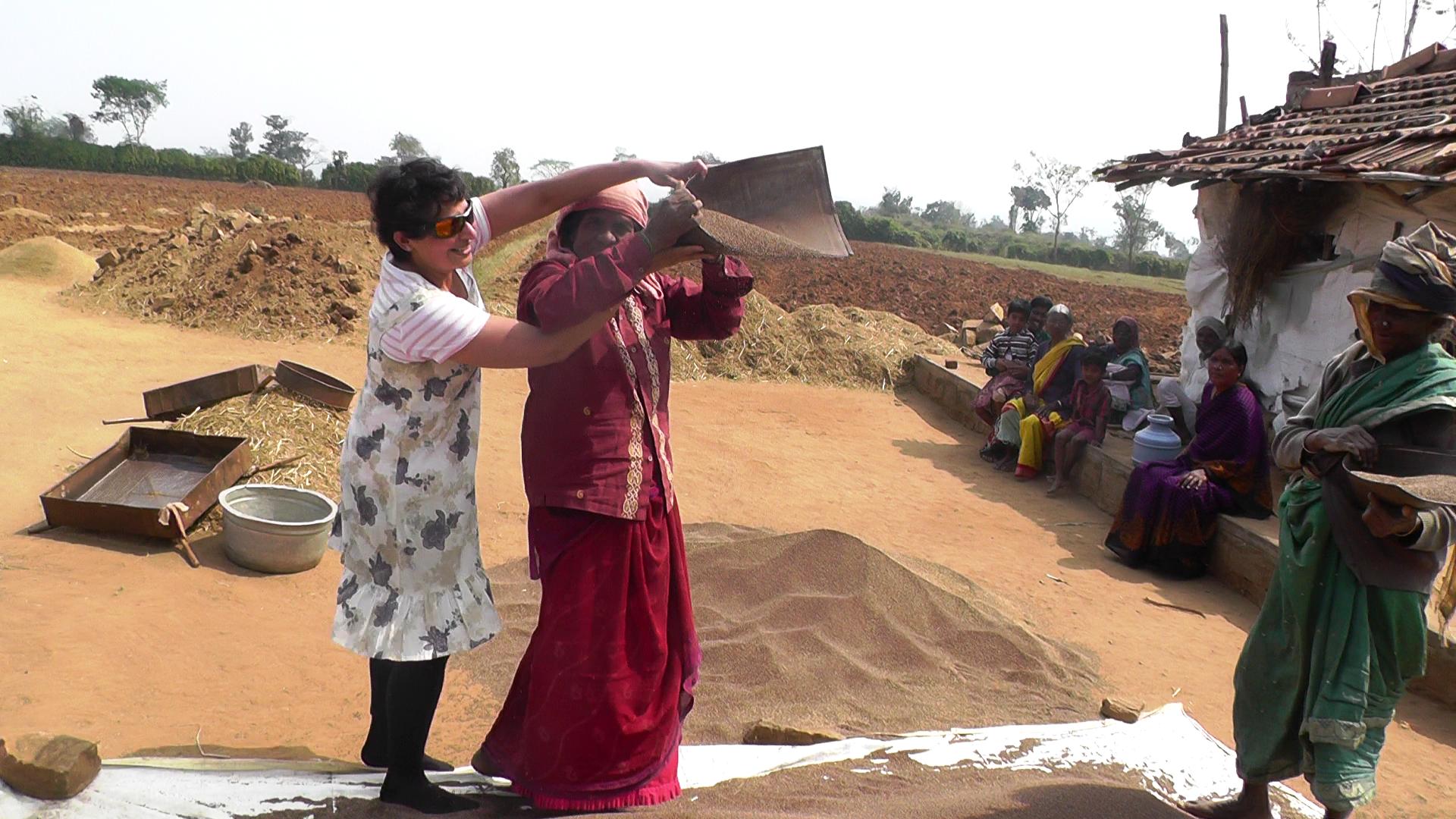 Sita Venkateswar learning to sieve millets while walking.