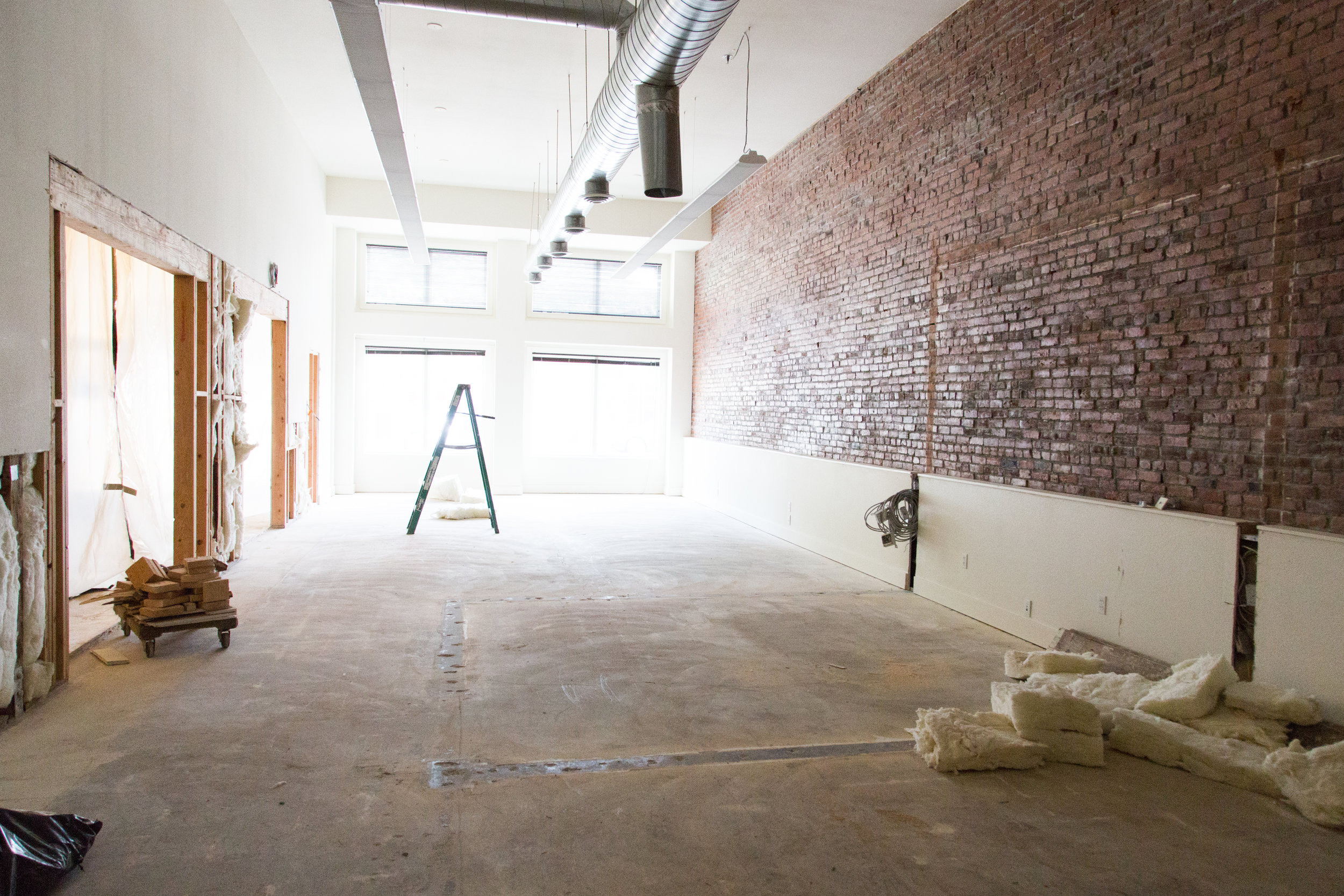 Microenterprise offices sans walls shows the huge transformation that the building has already gone through!
