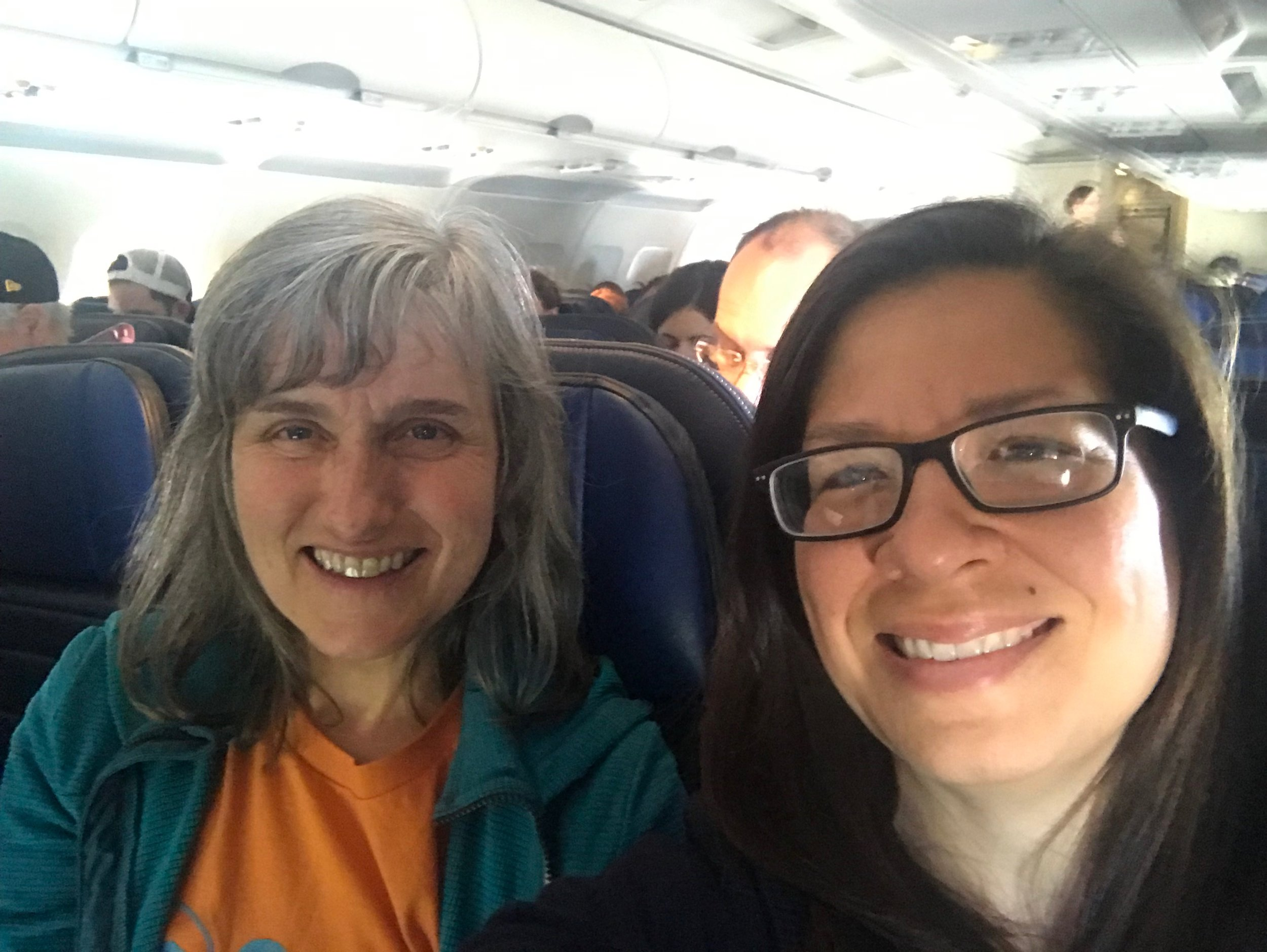 Bridget Cooke (left), Adelante Mujeres Executive Director, and Evelyn Cantoral (right), Adelante Mujeres Director of Development on the plane to NYC for the Renewal Awards.