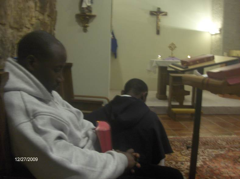 Brothers at prayer during weekly Adoration and Benediction.