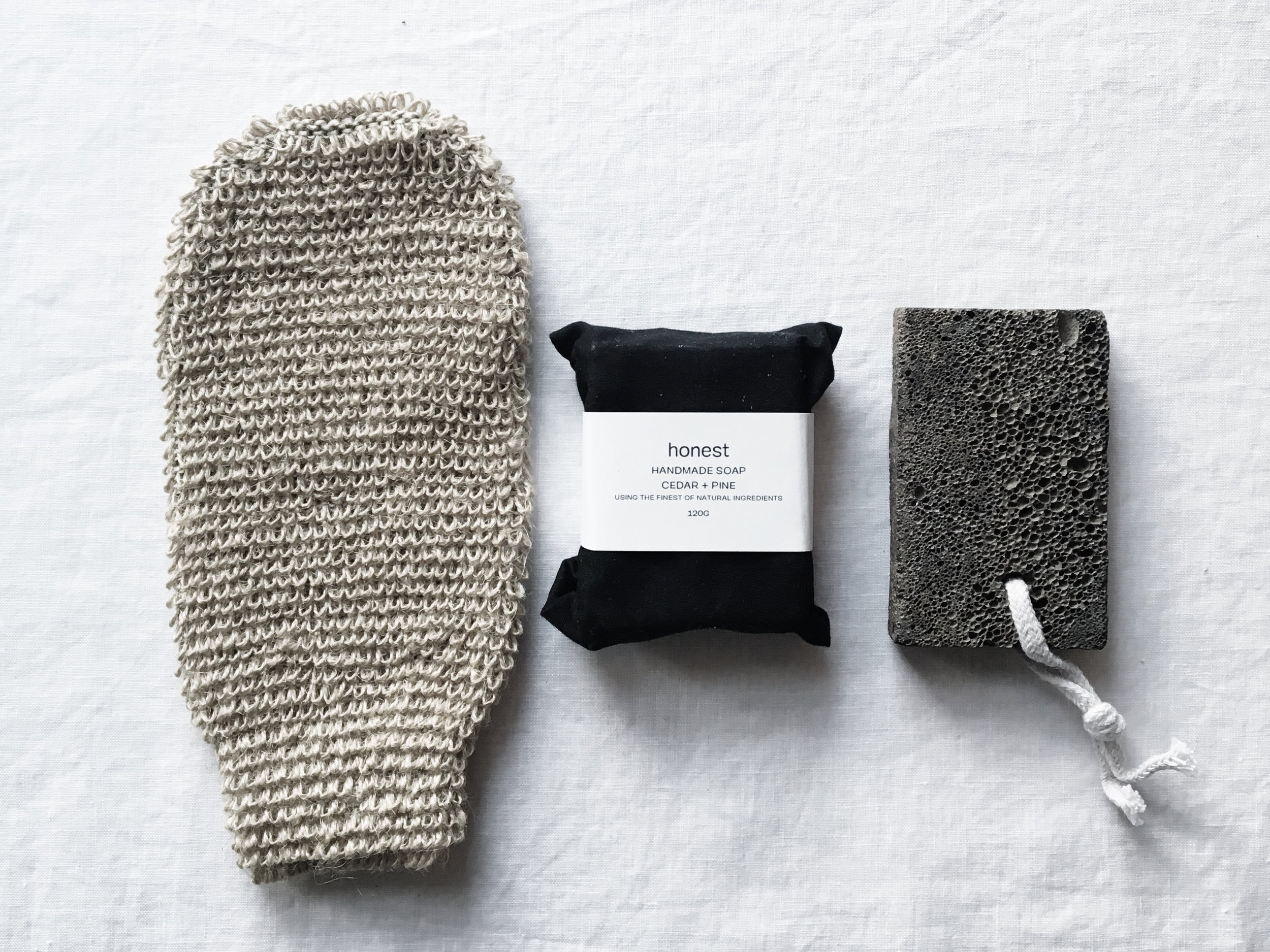 Face & Body Mitt  (£3) ,  Natural Foot Stone  (£5) and  Cedar + Pine Soap  (£12) from  Honest Skincare .