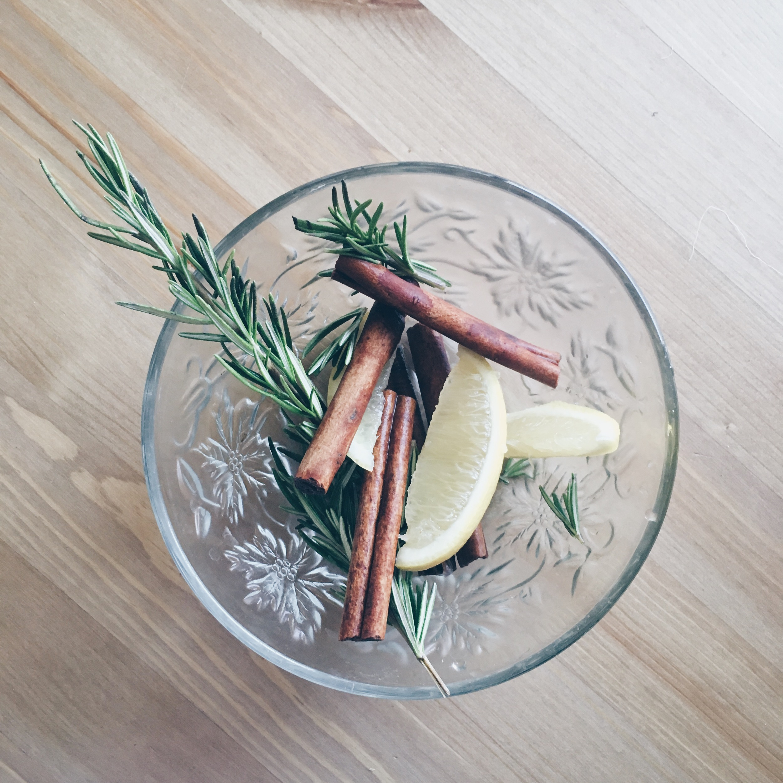 Homemade potpourri with cinnamon sticks, lemon, and rosemary. A perfect blend of fresh and festive. Check out my video  here  for more info.