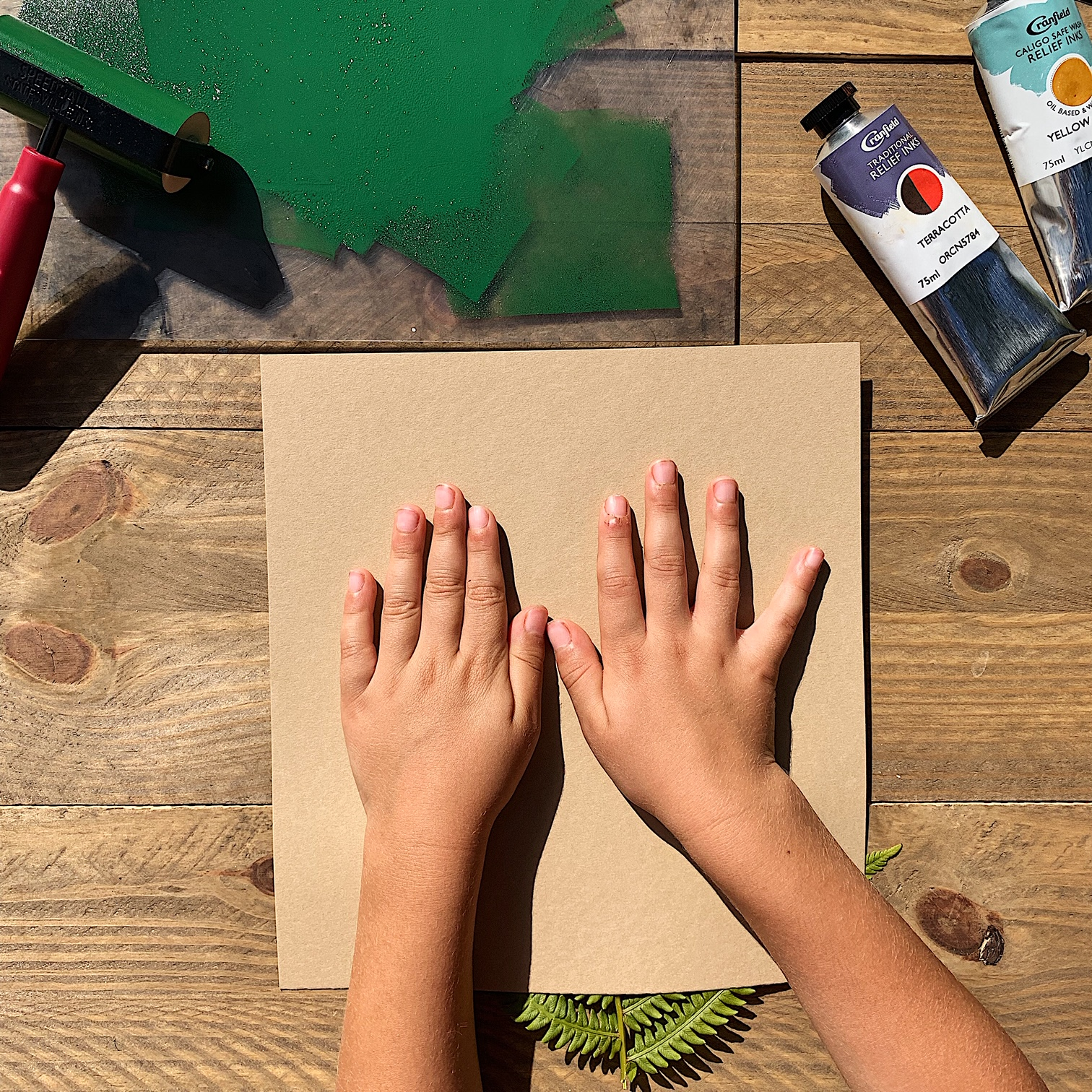 Place your paper - Carefully place your paper on the block. (Parents, if you're doing this with kids and want the image centered on the block, they might need help here.) Once it's on, push gently, careful not to wiggle the paper or let it slip.