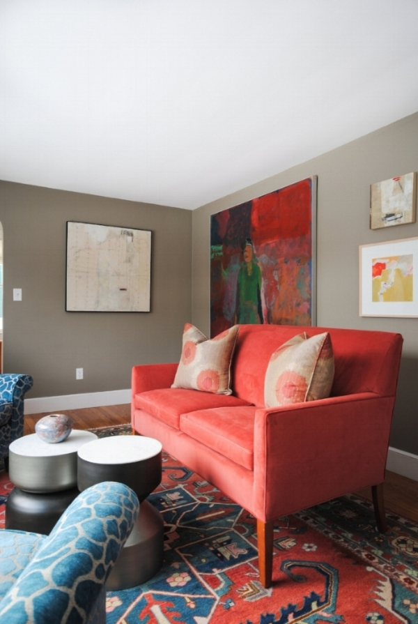"""Modern, practical accents from CB2 with a settee we reupholstered pair perfectly with the existing rug and turquoise chairs. The art, from left to right:  My favorite piece in the house is an encaustic called Mr. McBoingBoing by Maine artist Mary Path Hedstrom. The large painting behind the settee is called Summer Triptych 111 by Ed Douglass (MECA Faculty) and was a gift to the husband from his wife on his 50th birthday. It is one piece of a triptych. The upper right is """"Less is More 2"""" by Lynn Wessle, a New Orleans artist who summers in Maine. The lower right is a mono print entitled """" Lemon Sorbet"""" , by Jacqueline Carter. I believe between the foyer and living room we incorporated 13 or 14 pieces-not bad for a small space! The room tells a lovely story.  **Paint color is Benjamin Moore's Cole Stone"""