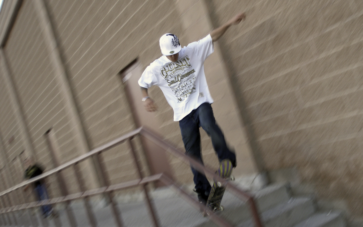 A skateboarder jumping a set of stairs with motion blur
