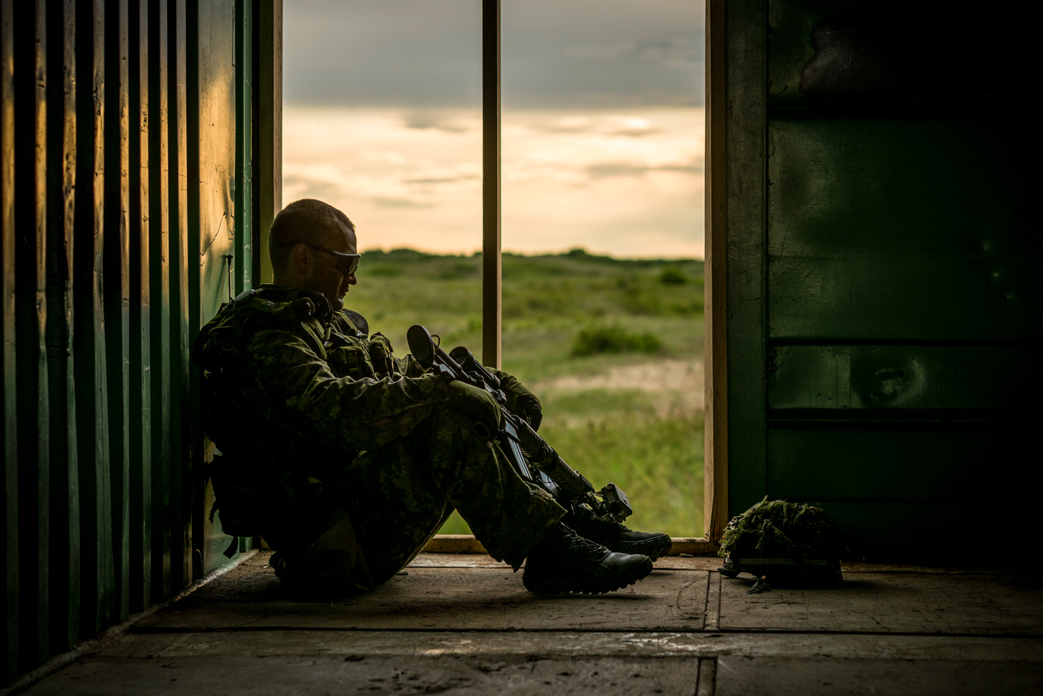 A member of the Canadian Armed Forces relaxes for a moment during exercise Maple Resolve in Edmonton, Alberta