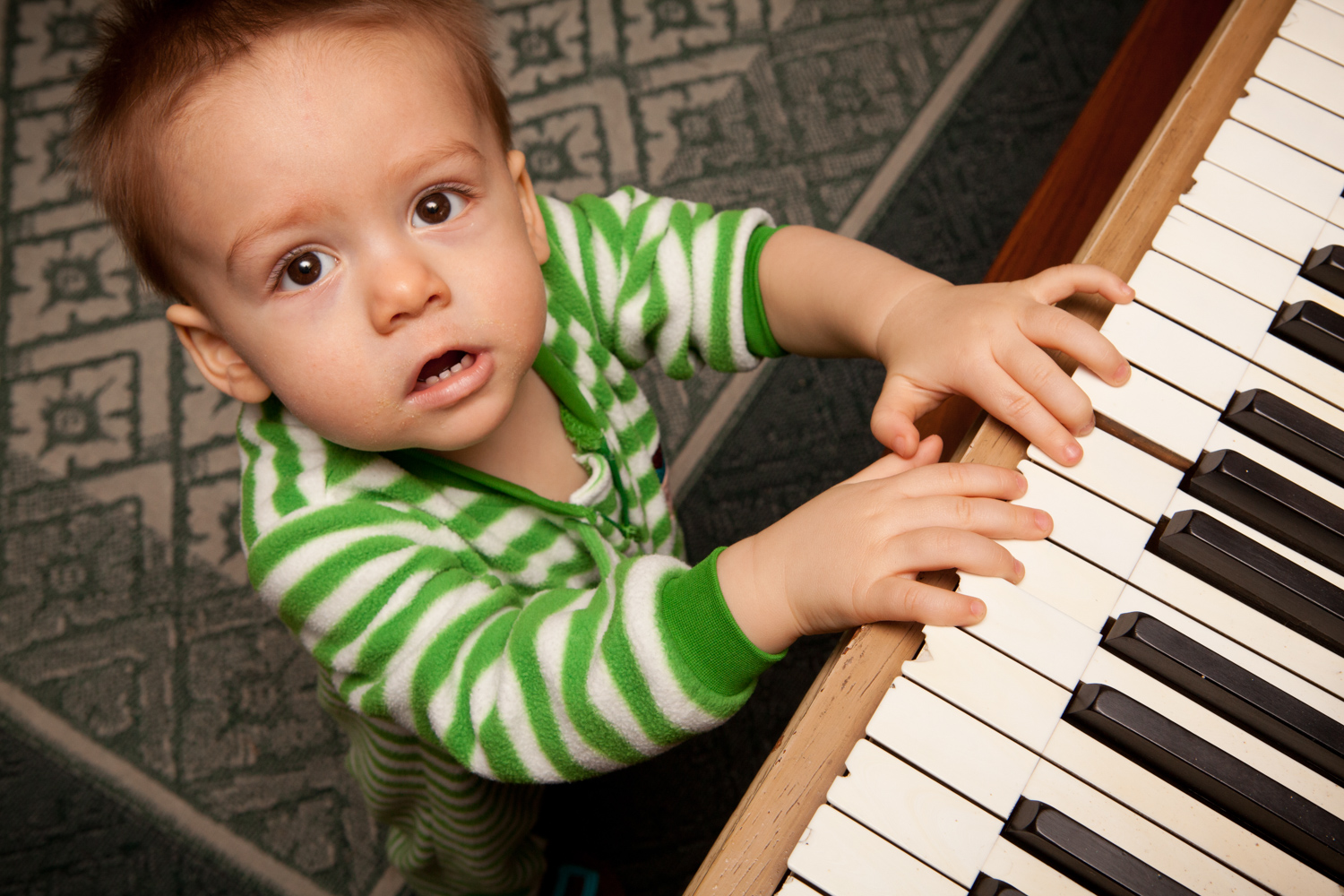 A little boy playing piano
