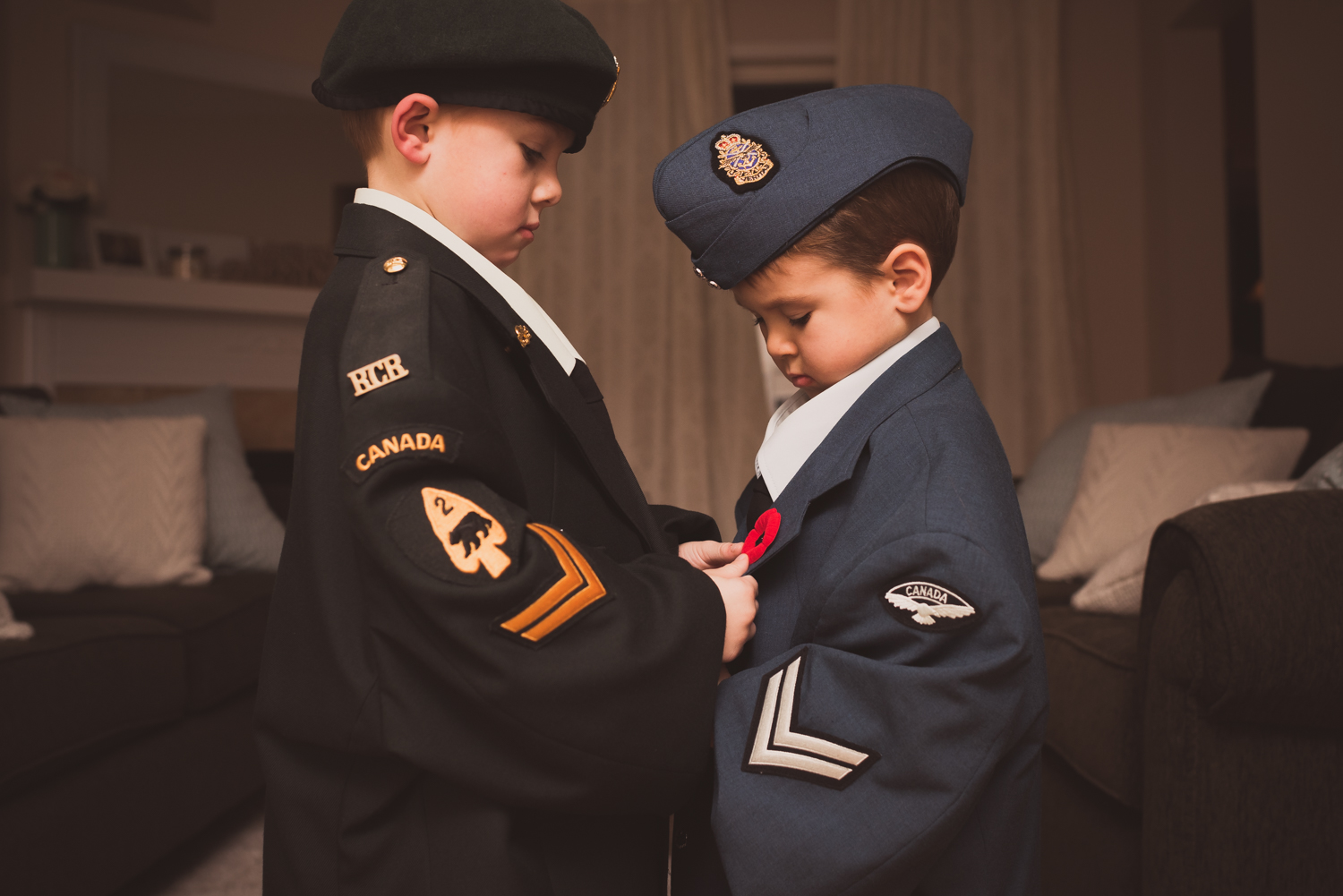 Two brothers dressed in military uniforms.