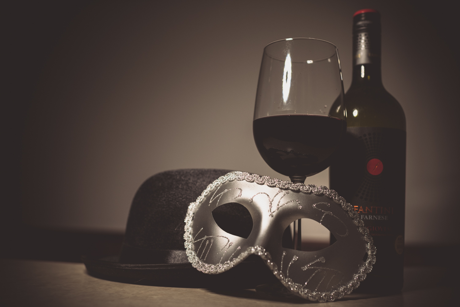 A mask, hat and some wine from a new years wedding celebration