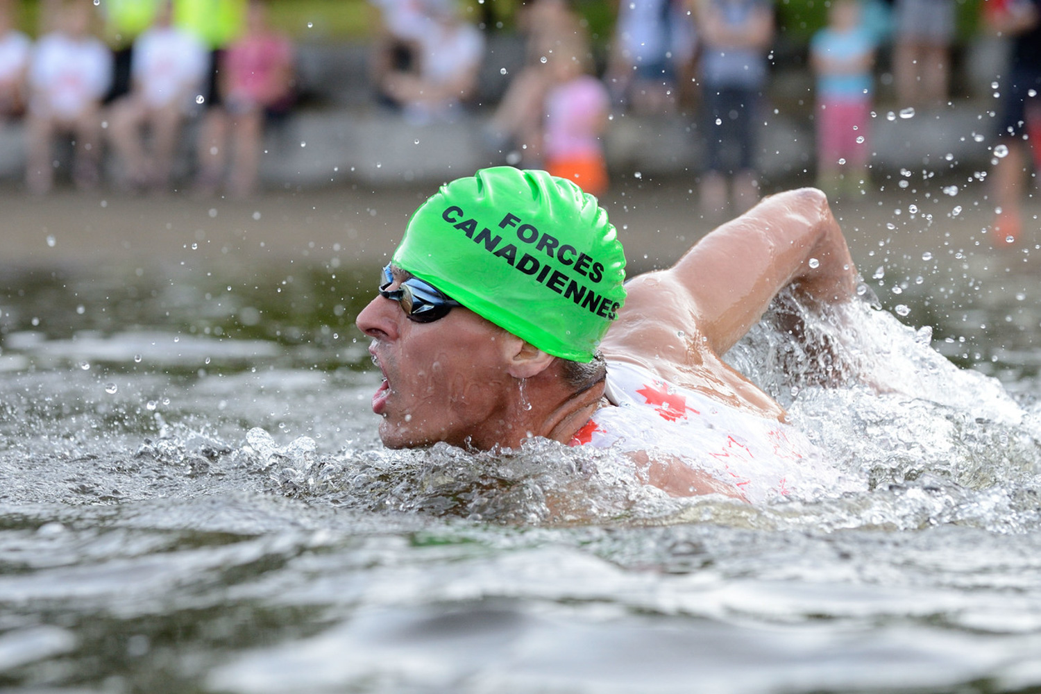 "A triathlete swimming during a triathlon held in lac Leamy in Gatineau, Quebec.  An example of one of our ""Peak of Action"" test requirements."