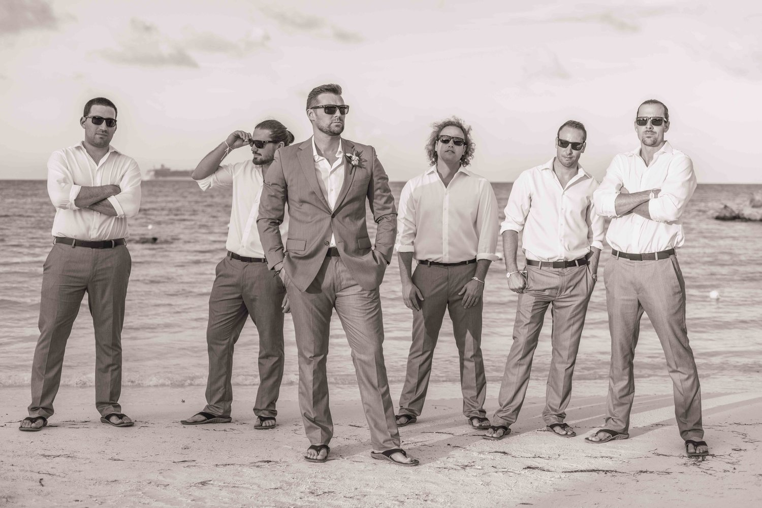 Groomsmen on a beach.
