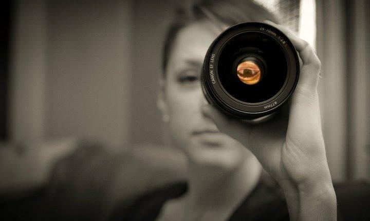 Whitney looking through a Canon lens