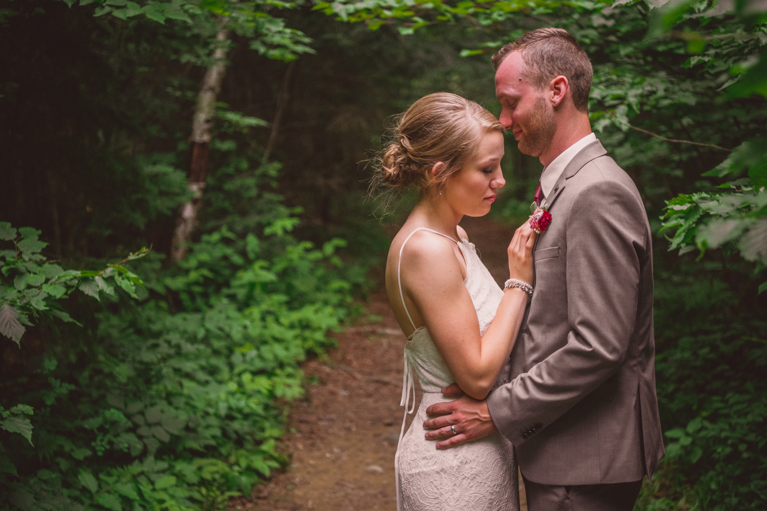 A beautiful moment between the two newlyweds in the woods in New Brunswick.