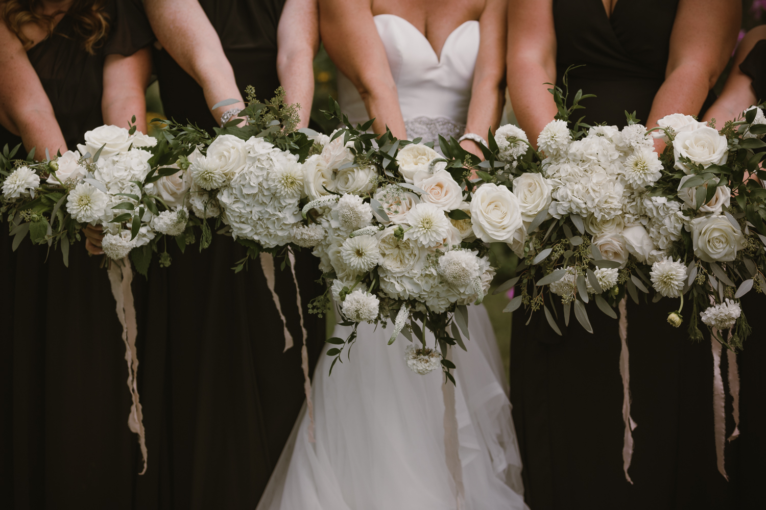 The bouquets of the bride and her bridesmaids