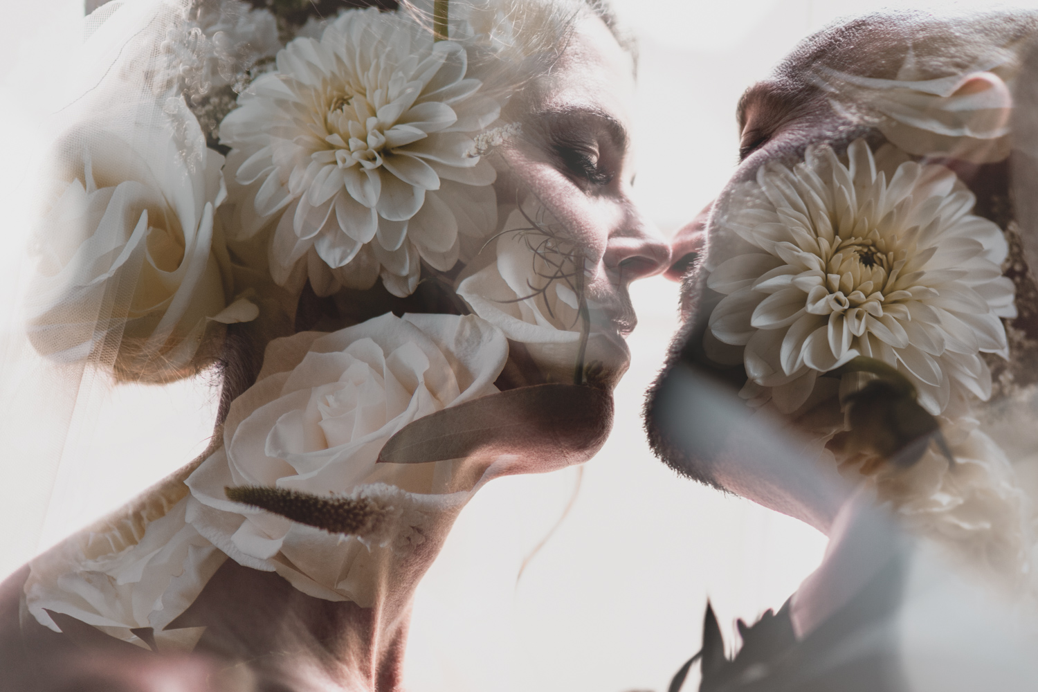A double exposure of the bride and groom, a wedding photo where their bouquet is overlaid with a photo of them kissing, taken the day of their wedding in Ottawa.