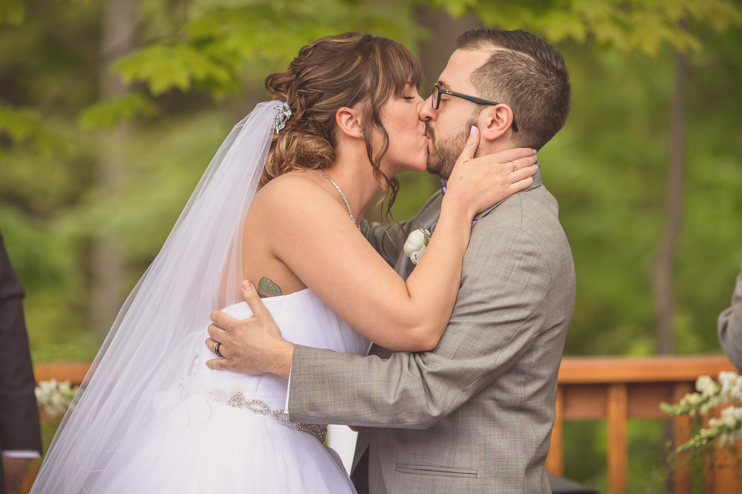 The bride and groom kiss right after saying their vows during the wedding ceremony in Mississauga, Ontario.