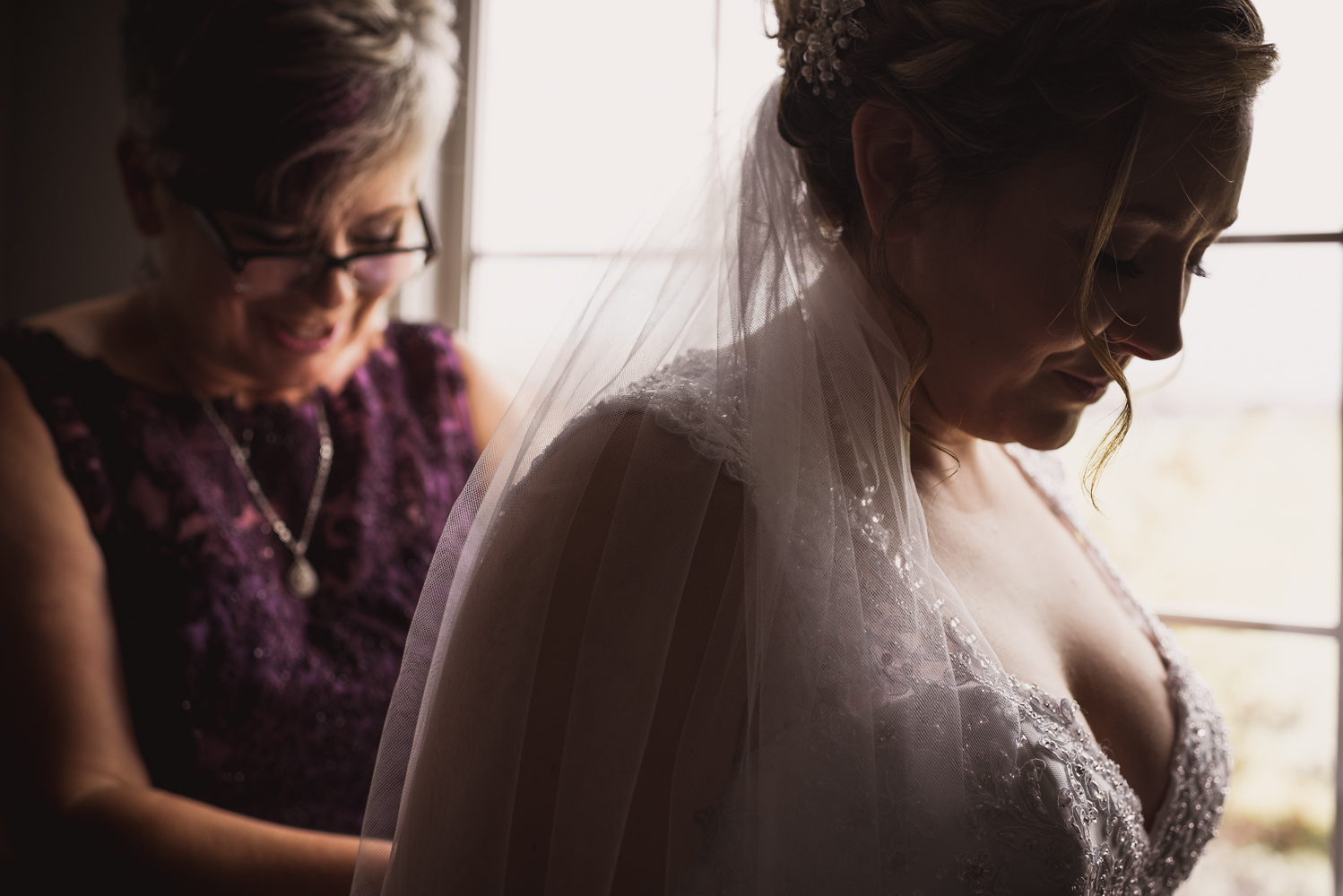 The bride and her mother getting ready for the wedding day in Cobden, Ontario!