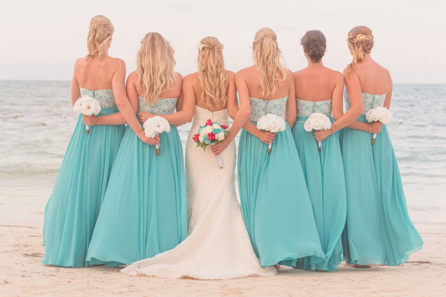 Laura and her bridesmaids along the beach of Kingston, Jamaica