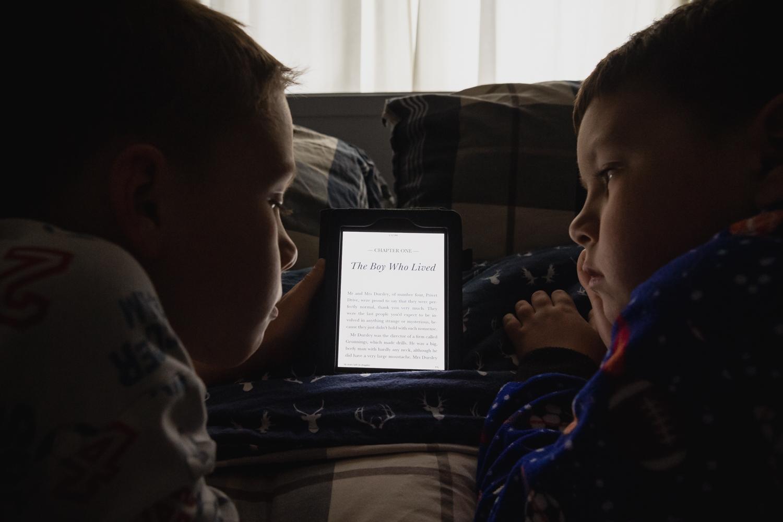 My boys reading a book on a kindle.
