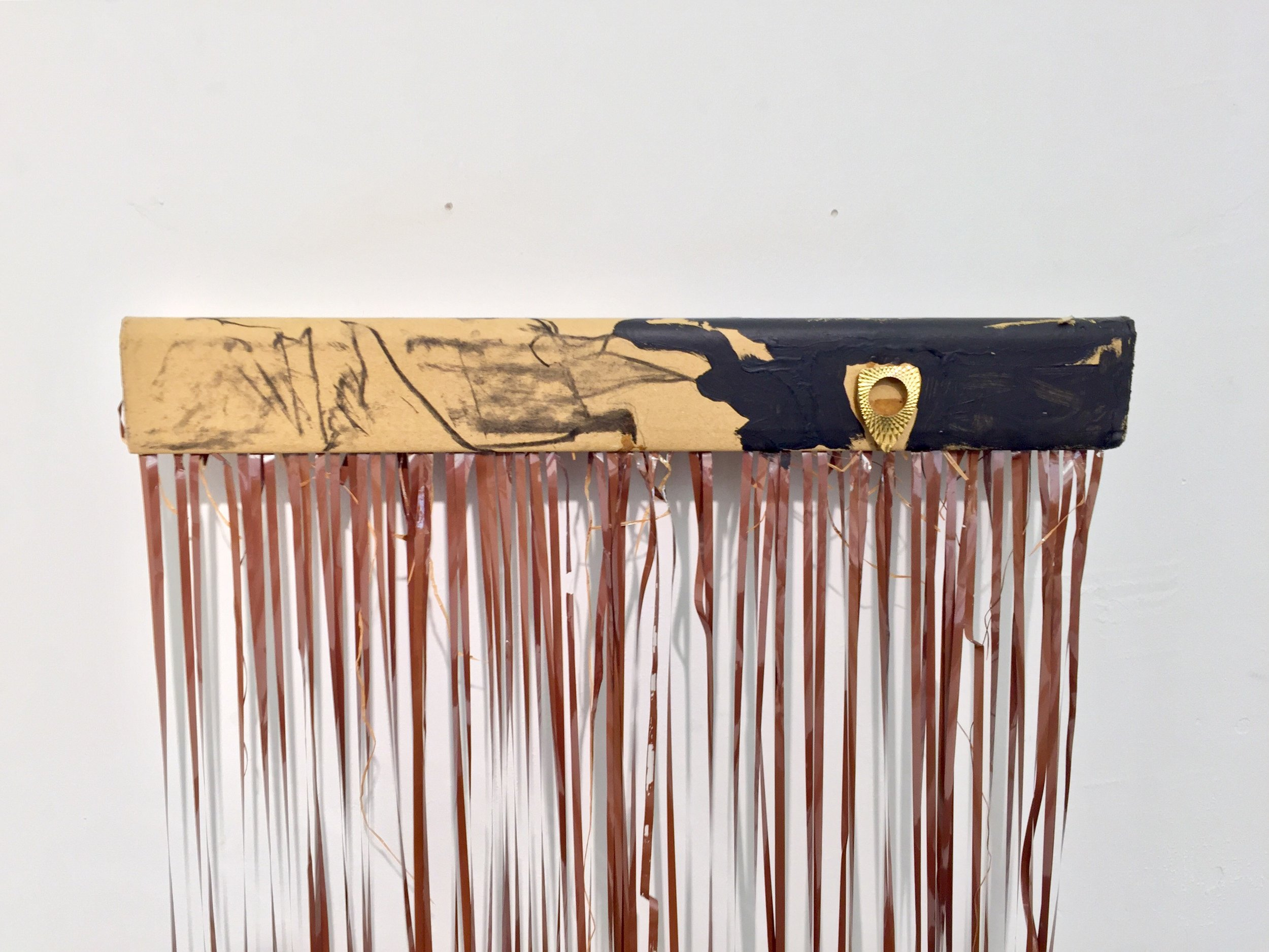 Side A/Side B (Memory's Tentacles)     (detail)  One cassette tape, vintage bezel, charcoal, acrylic paint, protective packaging, found coffee table  55 x 28 x 28 inches  2018