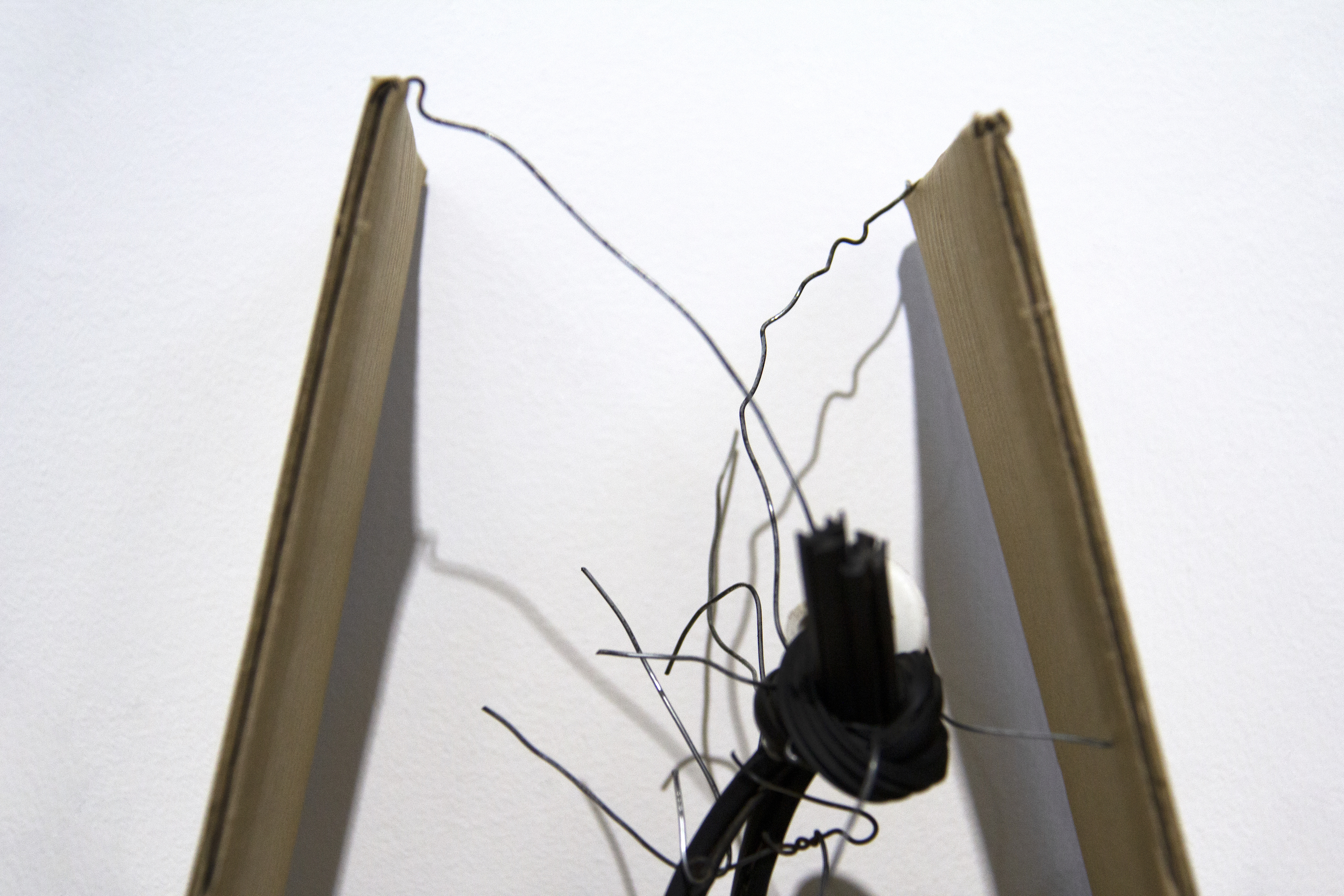 The cradle   (detail)  Used wire from funeral tent and cardboard packaging; found wooden structure, rubber tubing, plastic knob; and acrylic paint  Approx. 17 6/8 x 12 6/8 x 16 1/2 inches  2019