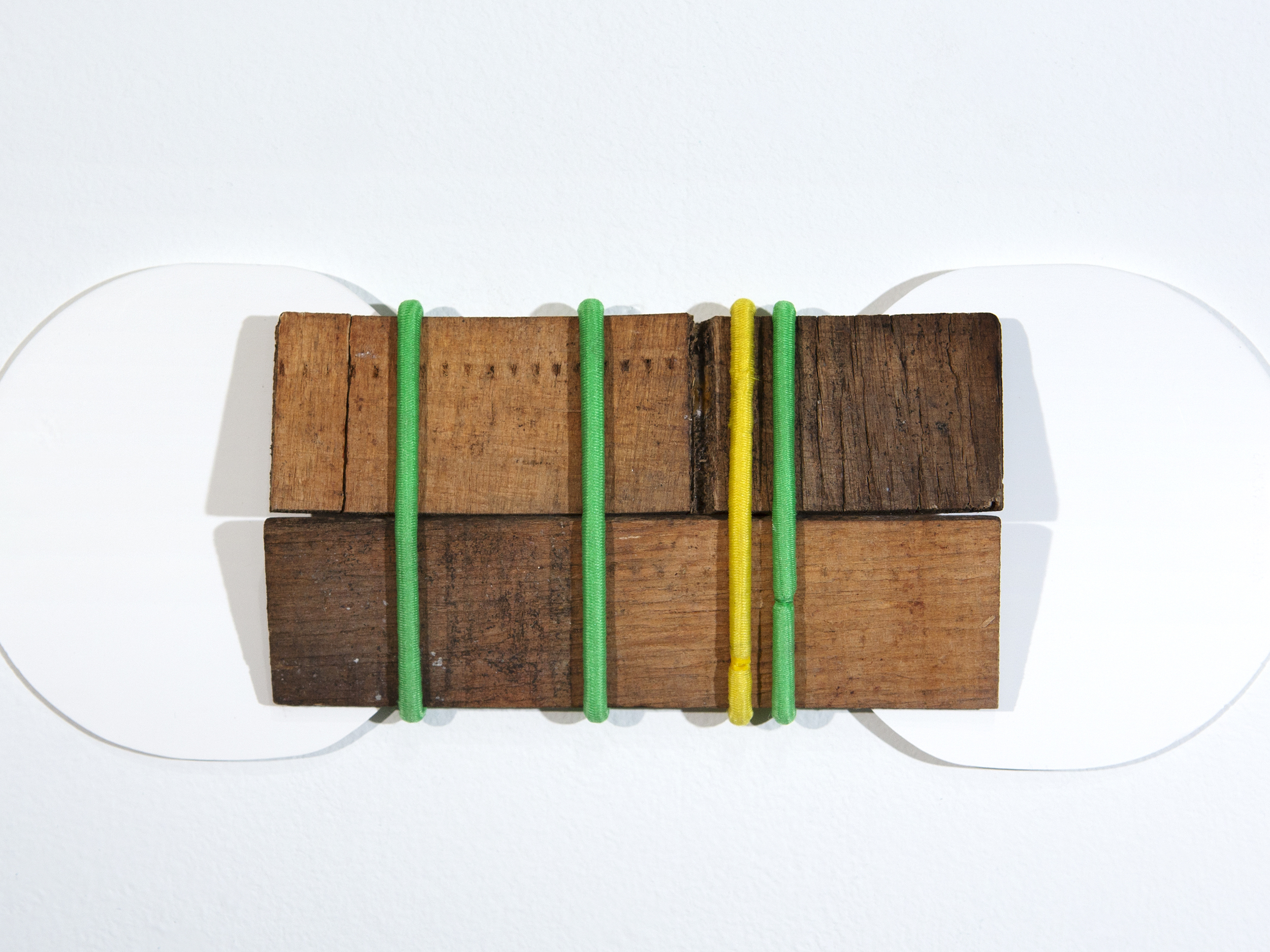 Walking out of time   (detail)  Used invisible socks insert, found wood and hair tie  9 1/2 x 3 1/2 x 1/2  2018