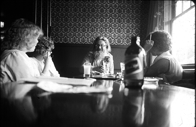 Writer Robin Skelton (1925 - 1997) at the Jack of Clubs Hotel with IMA students circa late 70s/early 80s