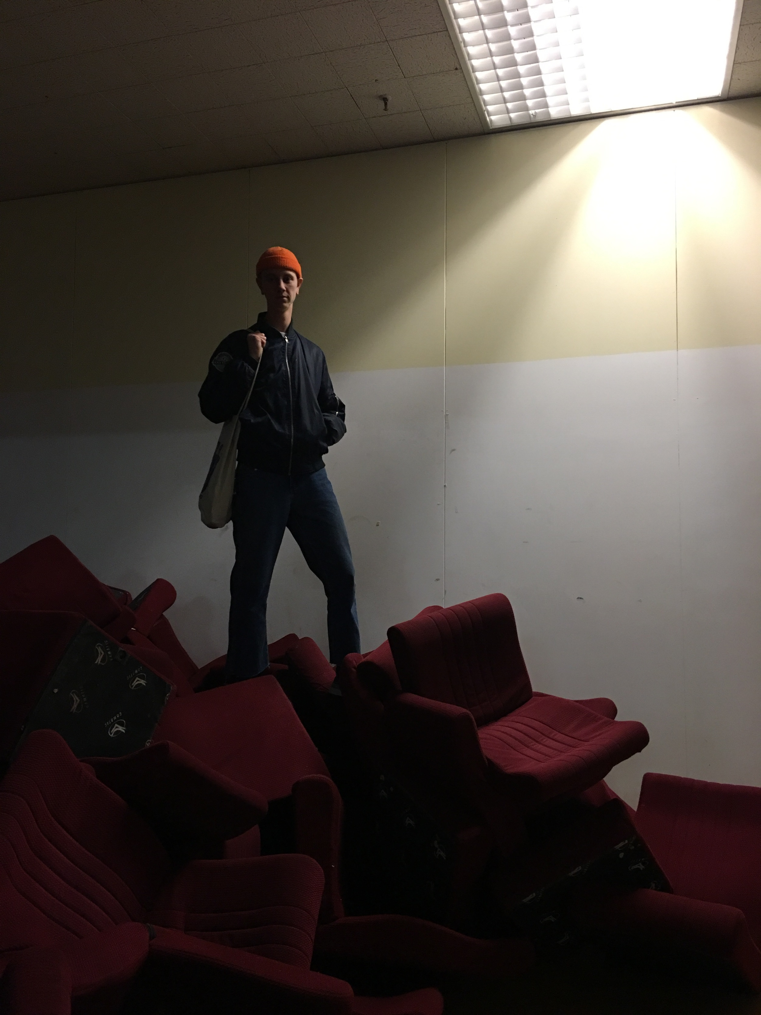 Small mountain of old cinema chairs, featuring Luke